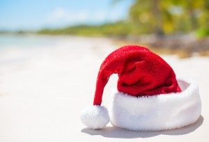 Red Santa Claus hat on beach